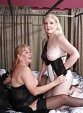 Blond-haired mature fucks her GILF-y girlfriend with a purple strap-on